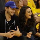 ) Actors Ashton Kutcher and Mila Kunis attend Game 2 of the 2016 NBA Finals between the Golden State Warriors and the Cleveland Cavaliers at ORACLE Arena on June 5, 2016 in Oakland, California. (Photo by Ezra Shaw/Getty Images)