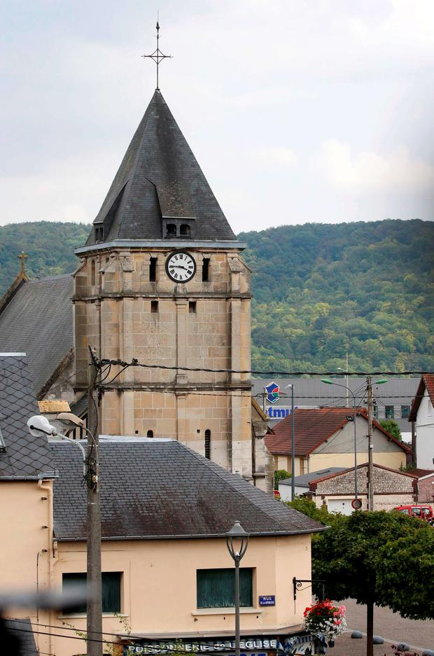 The bell tower of the church is seen after a hostage-taking in Saint-Etienne-du-Rouvray near Rouen in Normandy, France, July 26, 2016. REUTERS/Pascal Rossignol