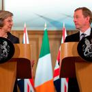 Prime Minister Theresa May and Irish Taoiseach Enda Kenny speak to the media inside 10 Downing Street, London, following the latest meetings on how Brexit will unfold. Stefan Rousseau/PA Wire