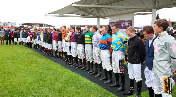 Jockeys including Ruby Walsh in the parade ring at the Galway Races observe a minutes silence for Jockey J T. McNamara who passed away. Pic Steve Humphreys 26th July 2016