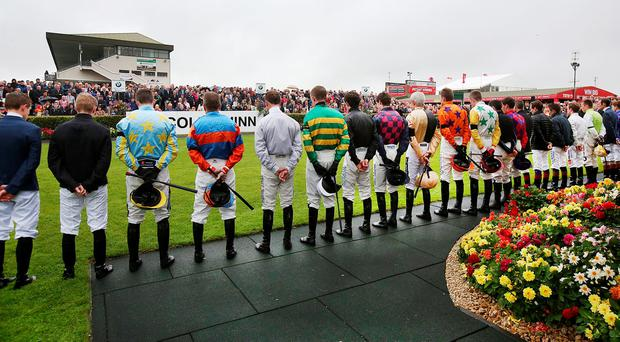 Jockeys in the parade ring at the Galway Races observe a minutes silence for Jockey J T. McNamara who passed away. Pic Steve Humphreys 26th July 2016