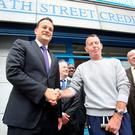 Social Protection Minister Leo Varadkar with Peter Crabbe, a member of Meath Street Credit Union, and James Bowden, its chairman, in Dublin yesterday. Photo: Tom Burke