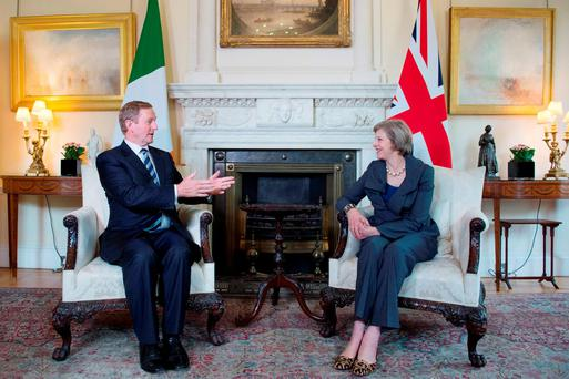 Taoiseach Enda Kenny with British Prime Minister Theresa May at No 10 Downing Street yesterday. Photo: PA