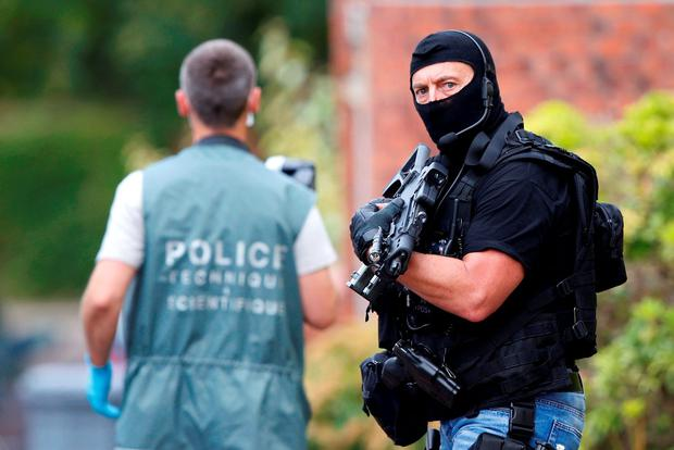 Members of French special police forces of Research and Intervention Brigade (BRI) and French scientific police are seen at the scene during a raid after the hostage-taking in the church in Saint-Etienne-du-Rouvray near Rouen in which Fr Jacques Hamel was murdered. Photo: Reuters