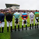 Fellow jockeys pay tribute to JT McNamara in Galway. Photo: Steve Humphreys