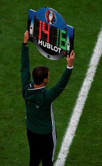 BORDEAUX, FRANCE - JUNE 11: The fourth official holds up to announce the substitution during the UEFA EURO 2016 Group B match between Wales and Slovakia at Stade Matmut Atlantique on June 11, 2016 in Bordeaux, France. (Photo by Dennis Grombkowski/Getty Images)