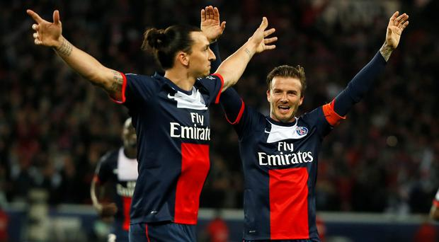 Zlatan Ibrahimovic (L) celebrates with David Beckham during their time at Paris Saint-Germain