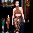 Gigi Hadid walks the runway during the Balmain show as part of the Paris Fashion Week Womenswear Spring/Summer 2016