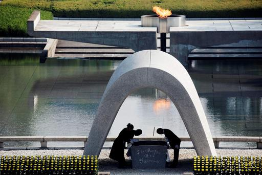 File photo, Kazumi Matsui, right, mayor of Hiroshima, and the family of the deceased bow before they place the victims list of the Atomic Bomb at Hiroshima Memorial Cenotaph during the ceremony to mark the 70th anniversary of the bombing at the Hiroshima Peace Memorial Park in Hiroshima, western Japan. (AP Photo/Eugene Hoshiko, File)