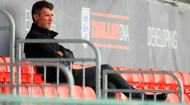 Roy Keane takes a seat in the stands before Barcelona's training session at St George's Park, Burton