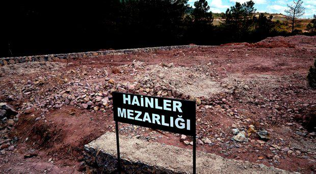 "A sign reading in Turkish ""Traitors' Cemetery"" is seen in front of unmarked graves, built specifically to hold the bodies of coup plotters who died in the failed military coup of July 15, in eastern Istanbul Wednesday, July 27, 2016."