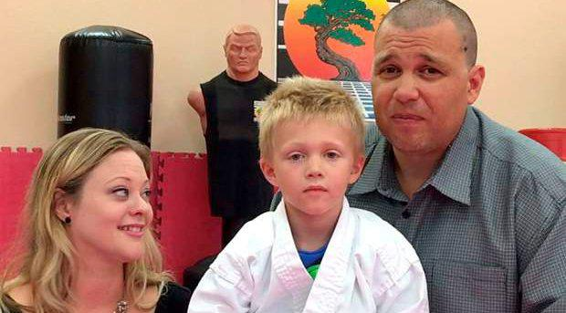 Liam Brenes, four, with his parents, Amanda McFarland, and Frank Brenes,