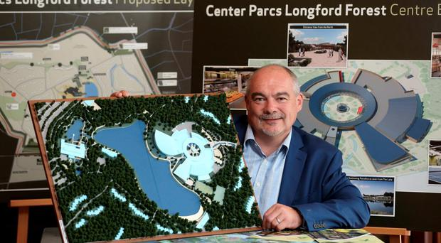 Martin Dalby, CEO of Center Parcs, holds a model of the proposed plans Photo: Jason Clarke