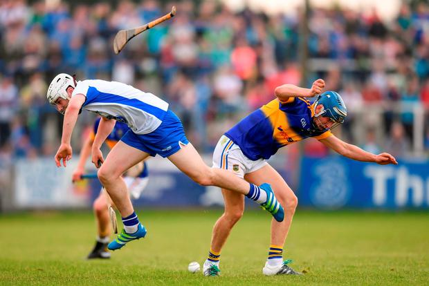 The clash of the ash between Waterford's Shane Bennett and Paul Maher of Tipperary results in a flying hurley at Walsh Park. Photo: Stephen McCarthy/Sportsfile