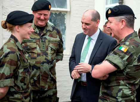 Defence Minister Paul Kehoe talks to members of the Defence Forces who are taking part in the 10-week pilot scheme for the unemployed, at Gormanstown Military Camp, Co Meath Picture: Defence Forces