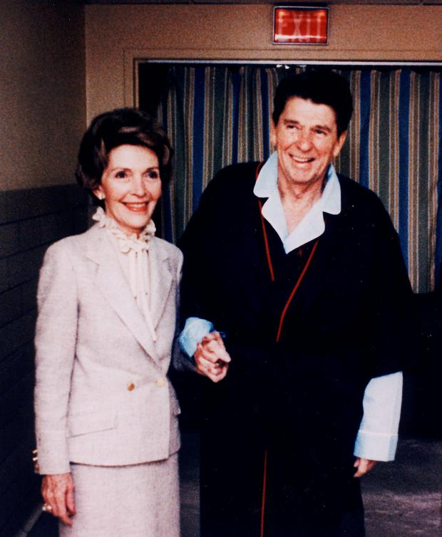 Reagan at a hospital in Washington alongside his wife Nancy, after the assassination attempt by John Hinckley. Photo: Reuters