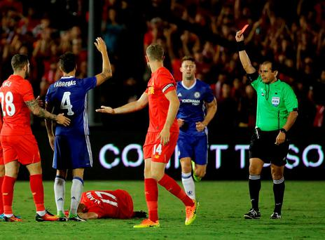 Cesc Fabregas #4 of Chelsea receives a red card from referee Baldomero Toledo after a hard challenge to Ragnar Klavan #17 of Liverpool in the second half during the 2016 International Champions Cup at the Rose Bowl in Pasadena, California. Chelsea defeated Liverpool 1-0. (Photo by Jeff Gross/Getty Images)