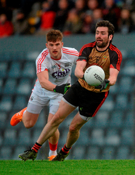 Kevin McKernan, Down, in action against Eoin Cadogan of Cork. Photo: Sportsfile