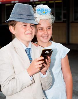 Ben (11) and Holly O'Rourke (10) chasing pokemon at the Galway Races yesterday. Photo:Andrew Downes