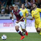 Sofiane Feghouli (L) in action against Alvaro Brachi (R) Photo: Srdjan Stevanovic via Getty Images
