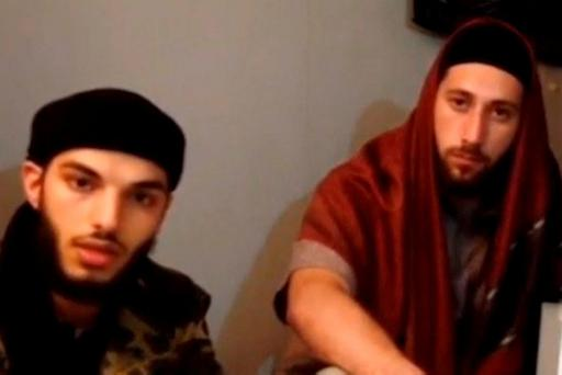 A still image taken yesterday from an undated video posted on social media by Isil, which it claims shows the two men who attacked the church in France. Photo: Reuters