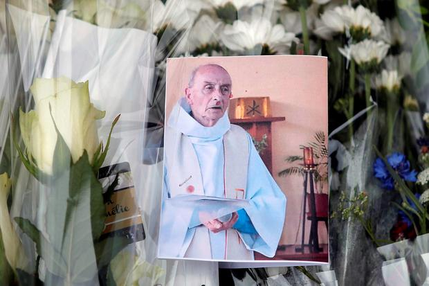 A floral tribute to Father Jaques Hamel. Photo: AP Photo/Francois Mori
