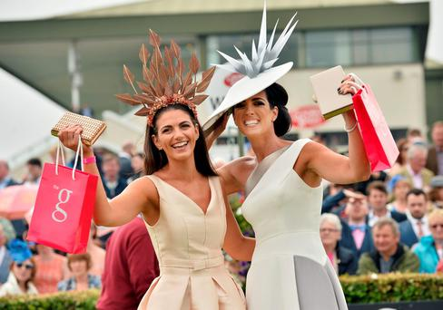 Lisa McGowan (right) from Tullamore, Co Offaly, was crowned Best Dressed Lady at the Galway Races at Ballybrit in one of her own designs, taking home the €10,000 prize. Garda Ciara Murphy (left) from Dunboyne, Co Meath, scooped the Best Hat title. Photo: Ray Ryan