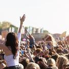 A young woman has claimed that she was escorted out of Knockanstockan music festival in Wicklow by six gardaí for doing what most of the men surrounding her were doing - enjoying the concert topless. (Stock photo)