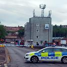 A road block in the Neepsend Lane area of Sheffield as police are searching a disused brewery after a man carrying what is believed to be a gun was seen entering the building Credit: Dave Higgens/PA Wire
