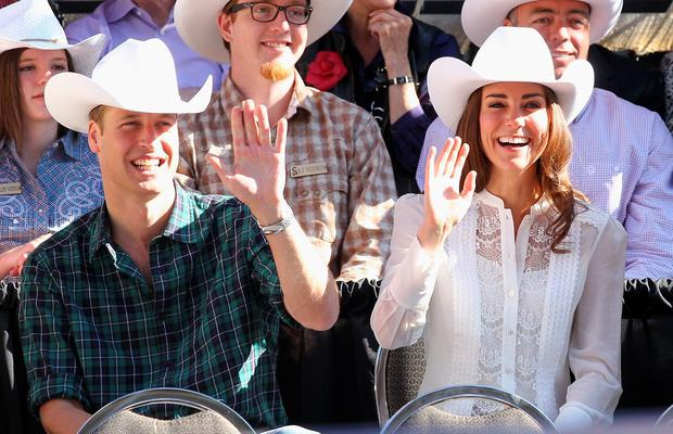 CALGARY, AB - JULY 08: Catherine, Duchess of Cambridge and Prince William, Duke of Cambridge wave as they attend the Calgary Stampede on July 8, 2011 in Calgary, Canada