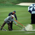 Workers push water off the 10th fairway after play was suspended during the second round of the PGA Championship golf tournament at Baltusrol Golf Club in Springfield, N.J., Friday, July 29, 2016. (AP Photo/Seth Wenig)