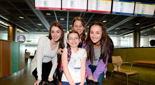 Denise (9), Rachel (17), Lavinia (21) and Mary Ruane from Galway heading off to Lanzorate at Dublin Airport