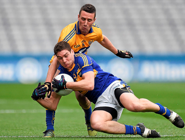Tipperary's Philip Austin in action against Clare's Shane Hickey in their 2014 Division 4 final. The two counties are back in Croke Park this weekend. Photo: Barry Cregg / Sportsfile