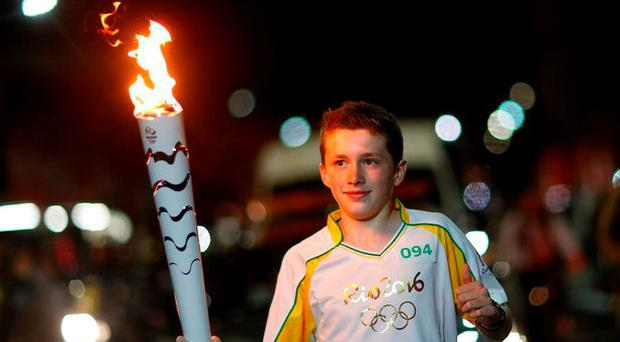 Mark O'Brien carrying the Olympic torch