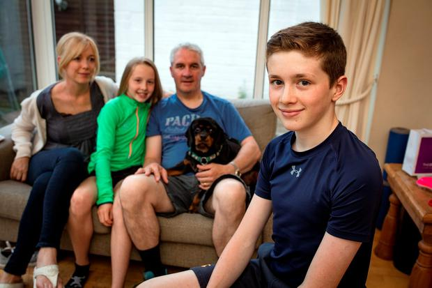 Mark O'Brien (13) pictured with his parents Joan and Frank and sister Isabel, age 11.