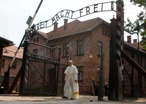 Pope Francis walks through the gate of the former Nazi death camp of Auschwitz in Oswiecim, Poland. Reuters/Kacper Pempel