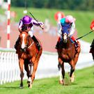 Minding ridden by jockey Ryan Moore on his way to winning the Qatar Nassau Stakes during day five of The Qatar Goodwood Festival