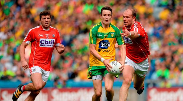 Eoin McHugh of Donegal in action against Alan O'Connor of Cork during the GAA Football All-Ireland Senior Championship Round 4B match between Donegal and Cork at Croke Park in Dublin. Photo by Oliver McVeigh/Sportsfile
