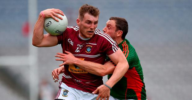 Kieran Martin of Westmeath in action against Keith Higgins of Mayo during the GAA Football All-Ireland Senior Championship Round 4B match between Westmeath and Mayo at Croke Park in Dublin. Photo by Ray McManus/Sportsfile