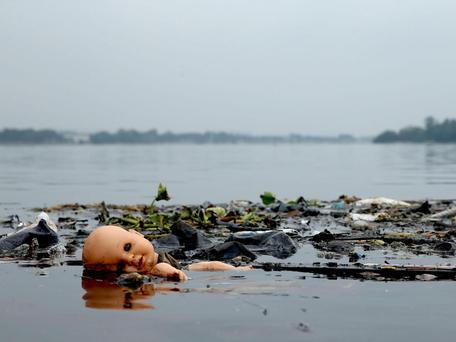 Pollution floating in Guanabara Bay. Matthew Stockman/Getty