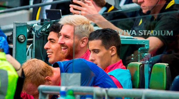Barcelona's Luis Suarez (left) and Lionel Messi (centre) on the bench during the 2016 International Champions Cup match at the Aviva Stadium