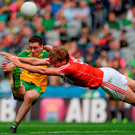 Cork's Ian McGuire is at full stretch as he attempts to block the effort of Donegal's Martin O'Reilly in Croke Park yesterday. Photo: Sportsfile