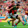 Kevin McLoughlin of Mayo in action against Kieran Martin of Westmeath during the GAA Football All-Ireland Senior Championship Round 4B match. Photo: Sportsfile
