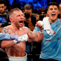 Carl Frampton and trainer Shane McGuigan, right, celebrate his victory over Leo Santa Cruz after their WBA super world featherweight championship boxing match at the Barclays Center, Brooklyn, New York, USA. Photo by Noah K. Murray/Sportsfile
