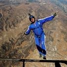 Skydiver Luke Aikins jumps from a helicopter during his training in Simi Valley, Calif.(AP Photo/Jae C. Hong)