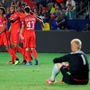 PSG players celebrate a goal as Leicester City keeper Kasper Schmeichel looks on. (Photo by Jeff Gross/Getty Images)