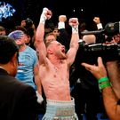 Carl Frampton celebrates his victory over Leo Santa Cruz of Mexico after their WBA super world featherweight championship boxing match at the Barclays Center, Brooklyn, New York, USA. Photo by Noah K. Murray/Sportsfile