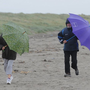 Two walkers on a rainy day at Dollymount Strand in Dublin. Photo: Damien Eagers