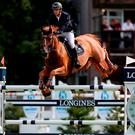 Ireland's Billy Twomey riding Lizziemary on their way to winning the Longines King George V Gold Cup during day six of the Longines Royal International Horse Show at Hickstead