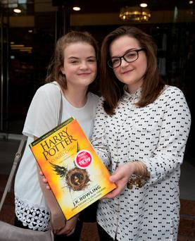 Heather Rowan and Emma Rowan with the new Harry Potter book. Pic: Mark Condren